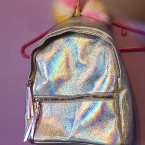 Under one sky holographic backpack (never used )